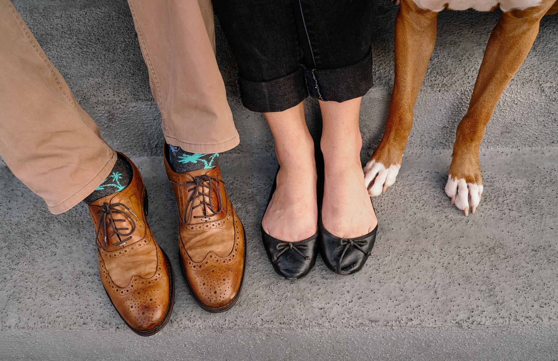 The-feet-of-a-couple-and-their-dog