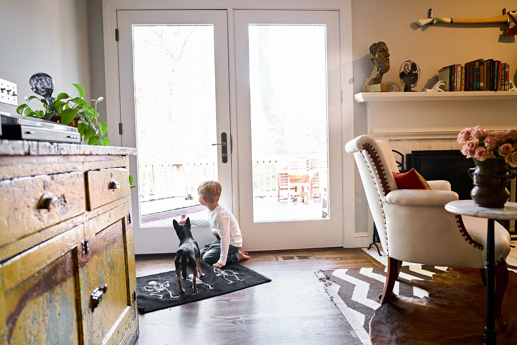 A-little-boy-and-his-dog-looking-out-the-back-door