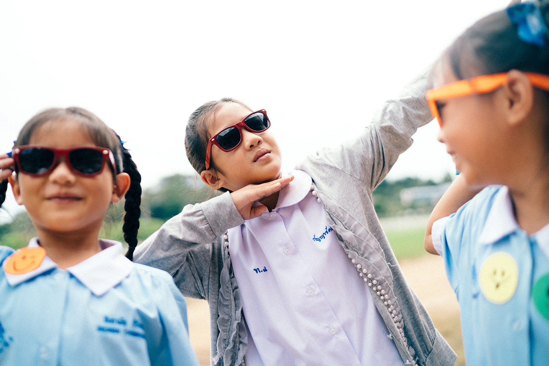 Three-young-girls-wearing-sunglasses-and-acting-silly